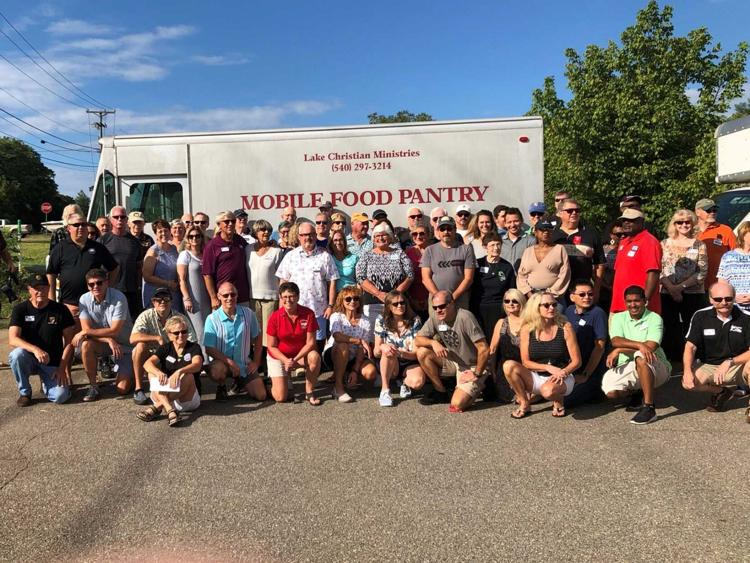 Porsche Club gathers to share food, donations for families